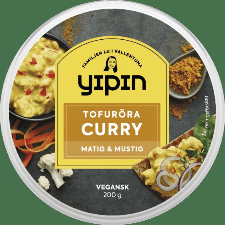 Bilden visar förpackningen till 200 g Yipin Tofuröra Curry, en vegansk curryröra.