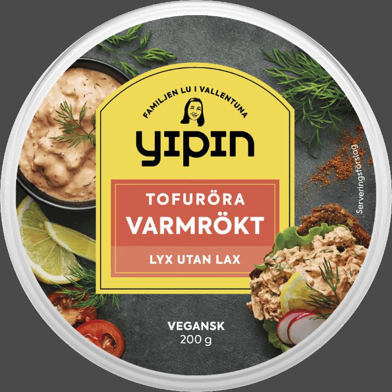 Bilden visar förpackningen till 200 g Yipin Tofuröra Varmrökt, en vegansk laxröra.